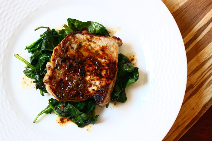 Ginger-Soy Glazed Pork Chops Over Wilted Spinach | Feast on the Cheap