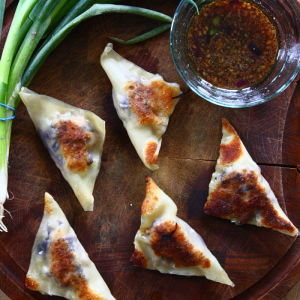 Curried Pork Potstickers with Soy-Ginger Dipping Sauce