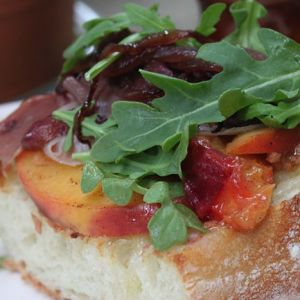 Open-Faced Peach & Prosciutto Sandwiches with Brie & Arugula