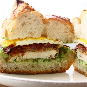 Crispy Chicken Sandwich Topped with a Fried Egg, Prosciutto and Spinach-Garlic Aioli