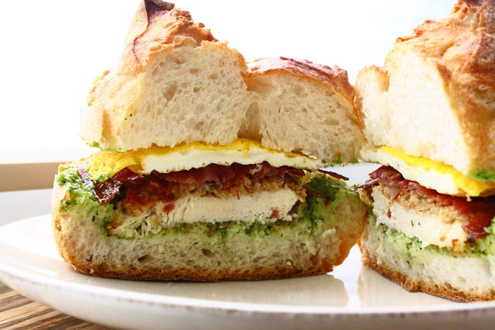 Crispy Chicken Sandwich Topped With A Fried Egg Prosciutto And Spinach Garlic Aioli Feast On