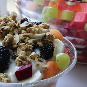 Fresh Summer Fruit Salad Topped with Yogurt and Granola